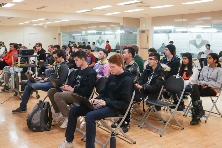 Hackers attending a tech talk